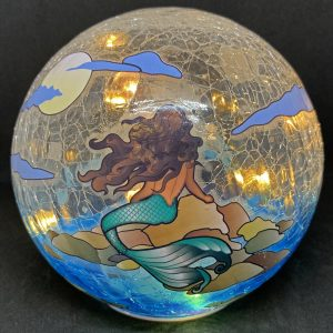 mermaid gazing globe and light
